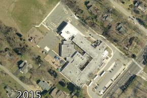 Color aerial photograph of Lemon Road Elementary School taken in 2015. Additional classroom spaces have been added to the rear and front right corner of the building.